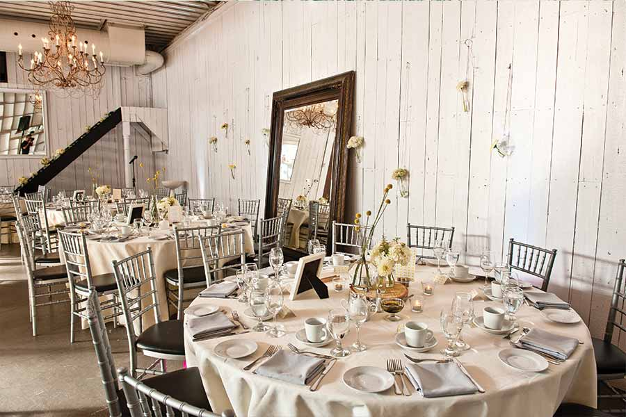 Cream coloured theme at the Berkeley Field House with flower centre pieces