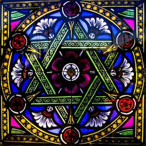 Stained glass masterpiece with yellow, blue and red colours