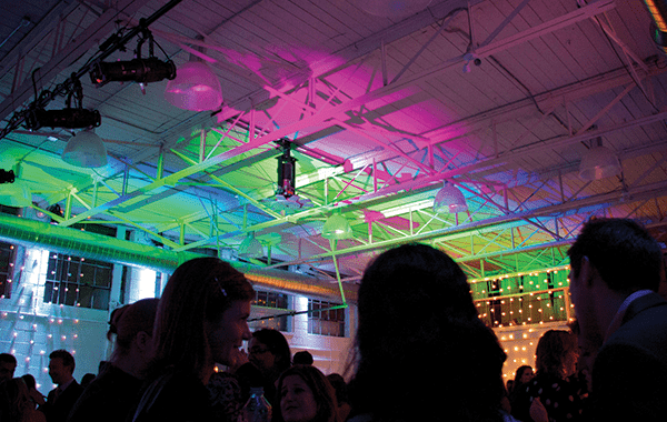 Pink and green light are projected onto the ceiling of Airship37 which a large amount of guests enjoy the entertainment.