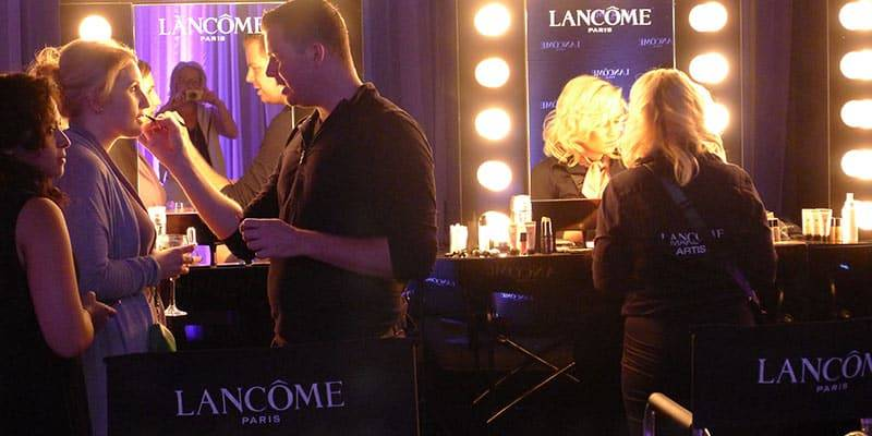 Lancome models getting makeup done by professionals