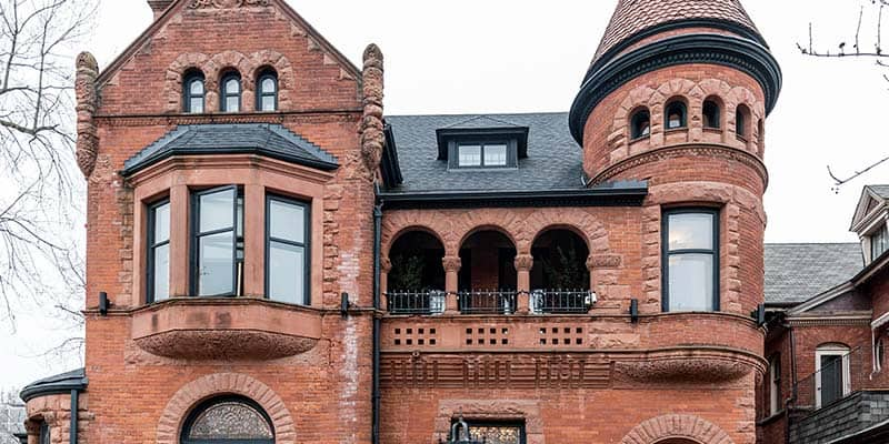 Outside of historic red brick mansion on Jarvis St in downtown Toronto