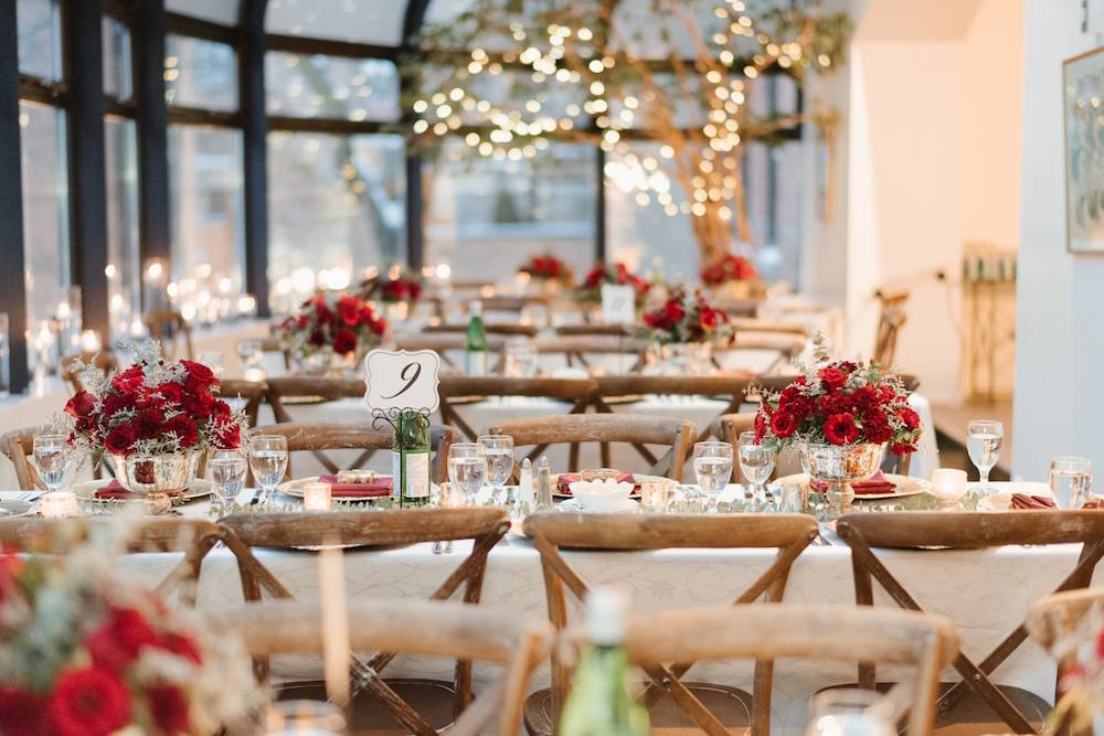 Red floral centrepieces at wedding reception