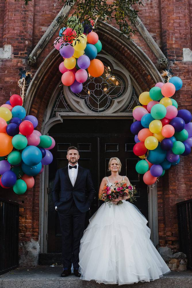 Bride and groom posing in front of Berkeley Church doors