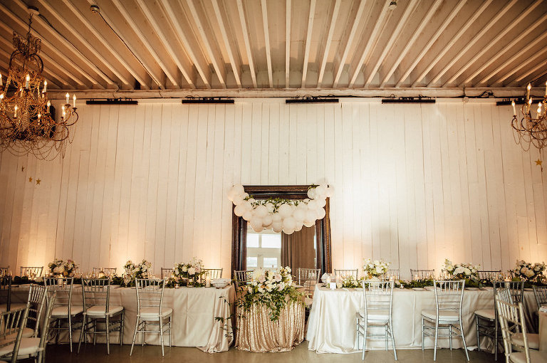 Gold and white wedding head table