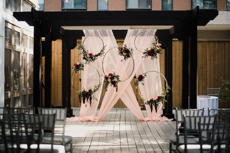 Floral wedding ceremony arch