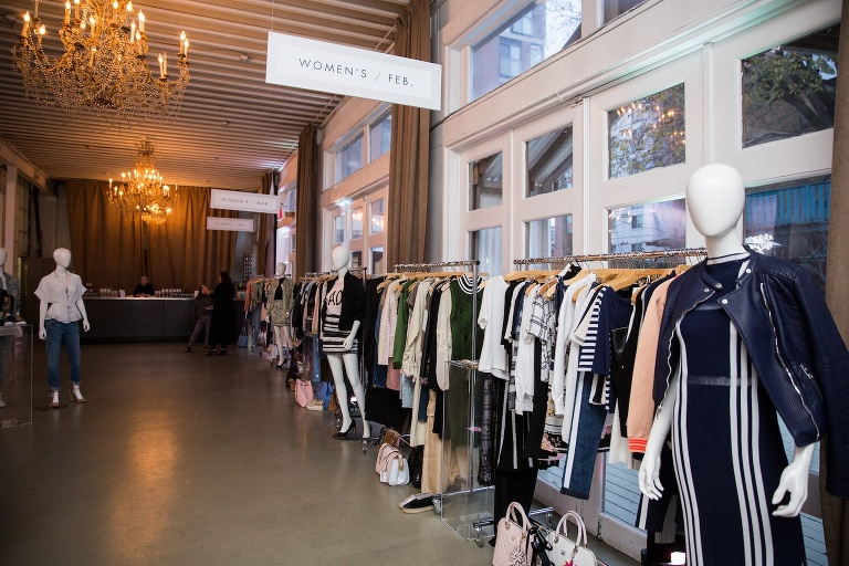 Clothing displayed on racks at product launch party