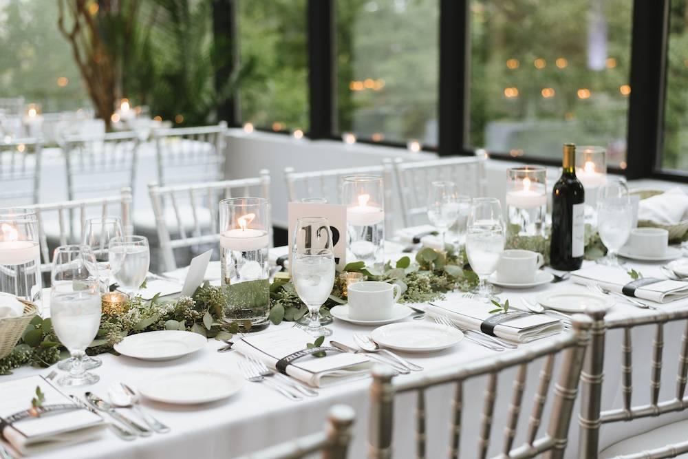 white and greenery tablescape decor at la maquette wedding reception