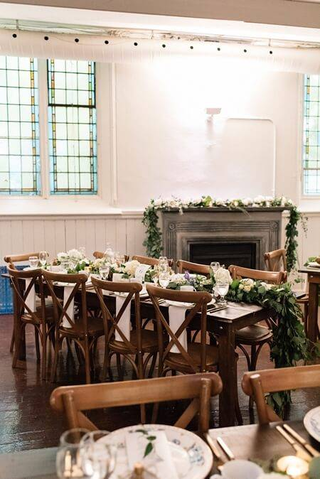 Beautiful simple floral wedding reception decor at Berkeley Church Toronto