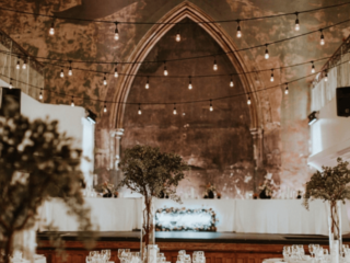 Tall greenery wedding reception centerpiece at the berkeley church toronto