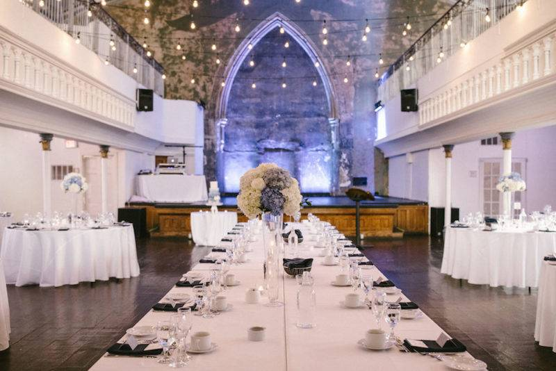 Purke and white floral wedding  reception at the Berkeley Church in Toronto