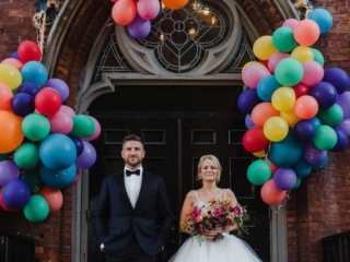 Bride and groom with balloon installation at the Berkeley Church Toronto