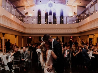 Bride and groom first dance under twinkle lights wedding reception berkeley church