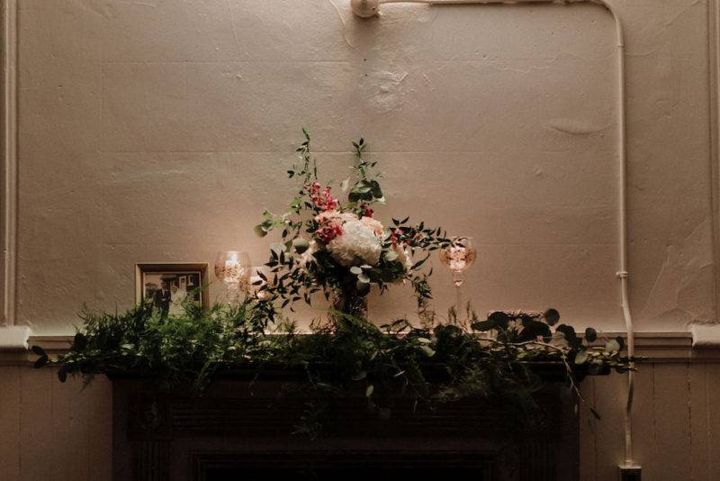 Floral arrangement above fireplace at Berkeley Church wedding venue