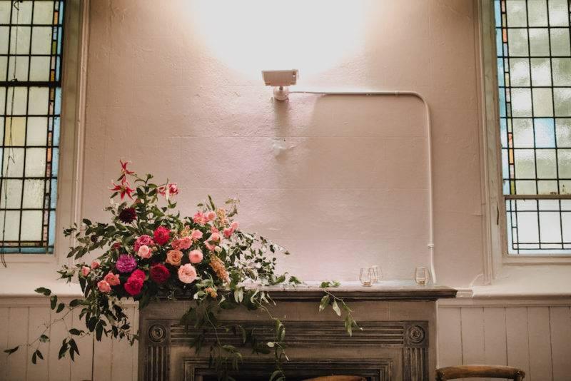 Floral arrangement upon fireplace at Berkeley church toronto