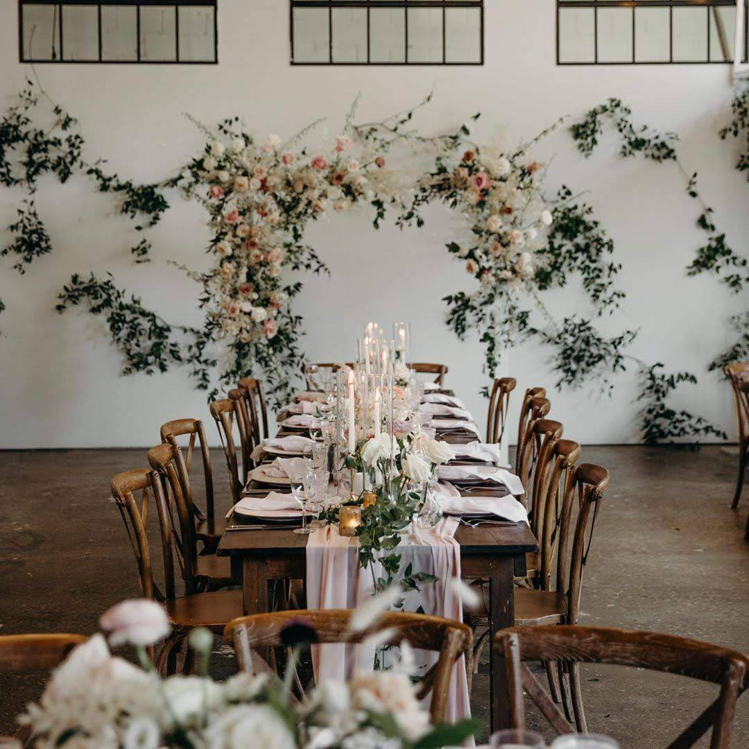 Floral wedding reception at Airship 37 historic distillery district toronto