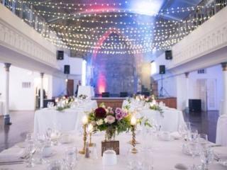 Beautiful purple greenery and white wedding reception at toronto berkeley church